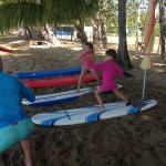 Kids surfing classes in Rincon, Puerto Rico.