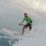 Surfing on a stand-up paddleboard in Rincon Puerto Rico.